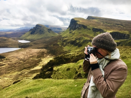Aimée Knight taking a photograph on the Isle of Skye.